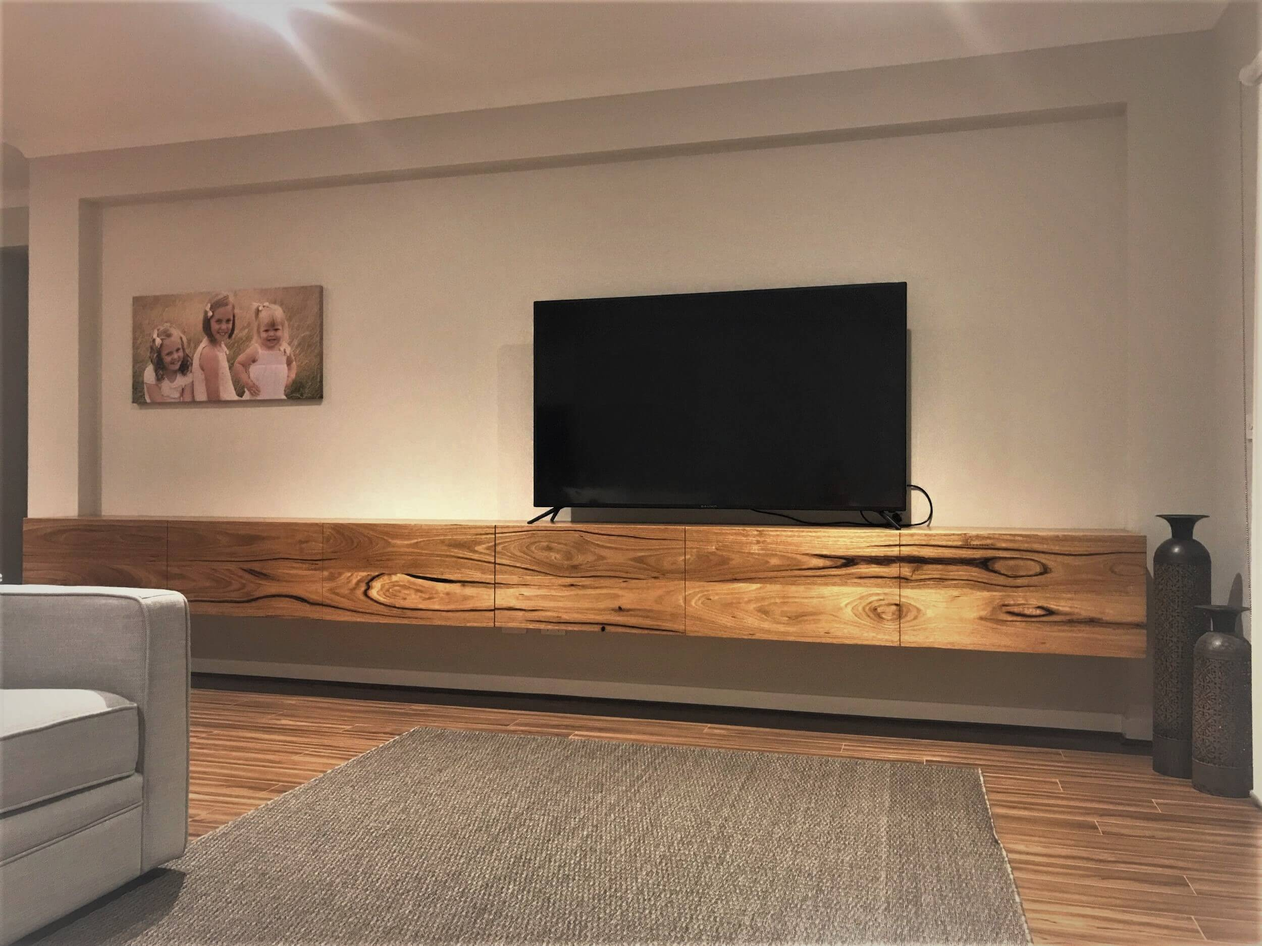 Modern TV on a wooden cabinet in the living room